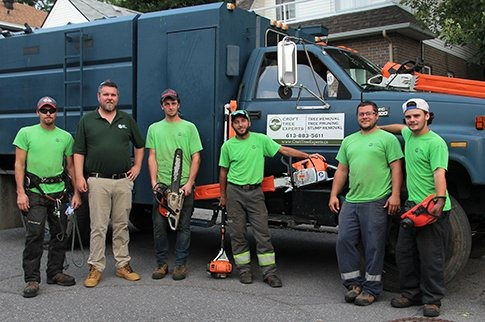 Croft tree employees in front of truck