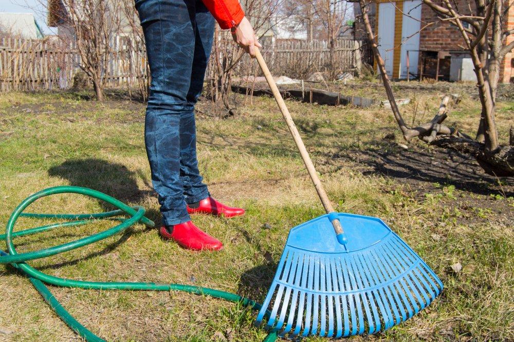 man raking yard
